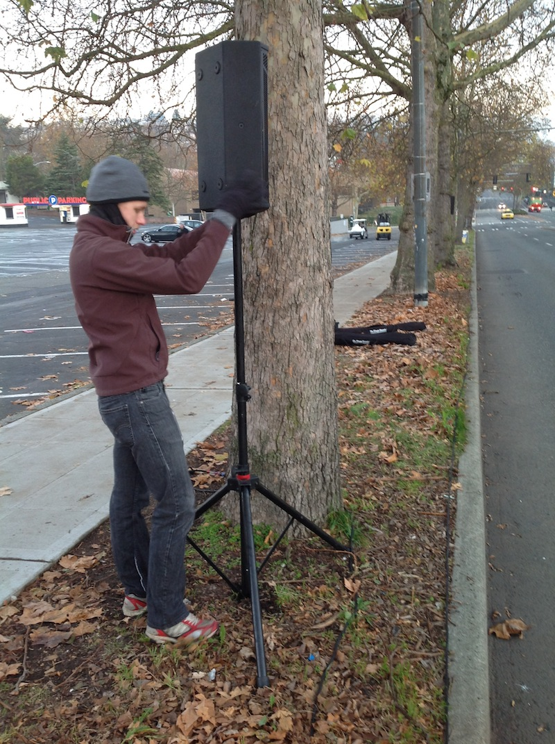 David Salonen setting up JBL STX-812M speakers at 2015 Amica Seattle Marathon